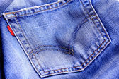 Fragment of blue modern jeans with pocket, can be used as a back — Stock Photo