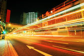 Traffic downtown at night — Stock Photo