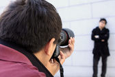 Young man photographer doing photos by digital camera — Stock Photo