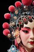 Chinese opera dummy and black cloth as text space — Stock Photo