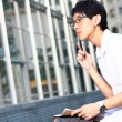 Young man studying at outdoor — Stock Photo