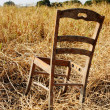 Royalty-Free Stock Photo: Broken wood chair in the dry grass field