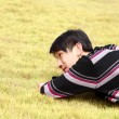 Young man lying on grass — Stock Photo