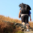 Stock Photo: Sport hiking in mountains, walking and backpacking