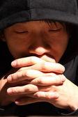 Closeup portrait of a young man praying to god — Stock Photo