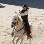Deputy Sheriff firing his gun on horseback — Stock Photo #5232652