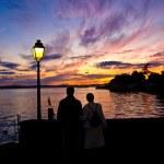 Romantic couple watching the sunset — Stock Photo #4111445