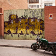 The gate with city graffiti. Barcelona — Stock Photo