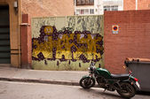 The gate with city graffiti. Barcelona — Stock Photo