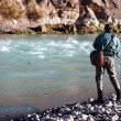 Fishing on mountain river - Stock Photo