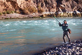 Fishing on mountain river — Stok fotoğraf