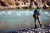 Fishing on mountain river — Stockfoto