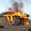 Stock Photo: Fire in an abandoned house