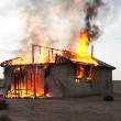 Fire in an abandoned house - Stock Photo
