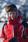 Wuman in red on ski slope portrait — Stock Photo
