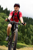 Asian mountain biker — Stock Photo