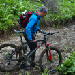 Stock Photo: Mountain bikers and mud terrain