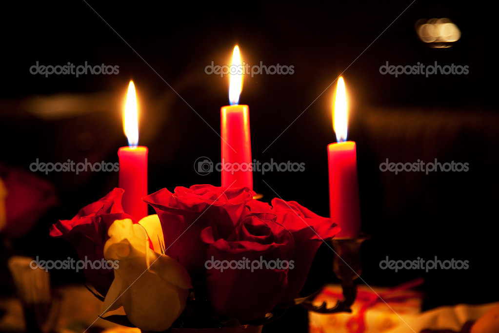 Rose and three candles in the evening restaurant — Stock fotografie #4382969