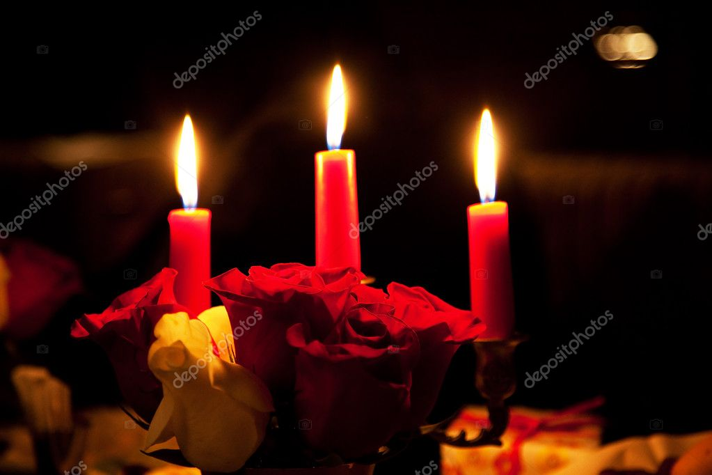 Rose and three candles in the evening restaurant  Zdjcie stockowe #4382969