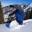 Backpacker goes deep in snow — Stock Photo #4419232