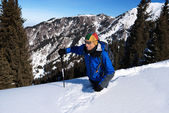 Backpacker goes deep in snow — Stock Photo
