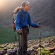 Backpacker in summer mountains — Stock Photo