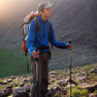 Stock Photo: Backpacker in summer mountains