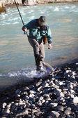 Fishing on mountain river — Stock Photo