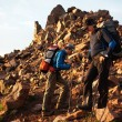 Two backpackers in morning mountains — Stock Photo