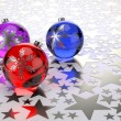 Christmas balls on silver stars background — Stock Photo