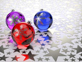 Christmas balls on silver stars background — Stock Photo