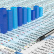 Stock Photo: Blue spreadsheet and pen