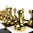 Golden Chess pieces — Stockfoto