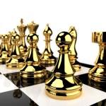 Golden Chess pieces — Stock Photo