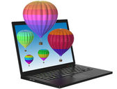 Laptop and 3D balloons — Stock Photo
