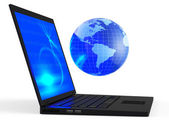 Laptop with illuminated globe — Stock Photo