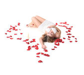 A girl lieing among rose petals — Stock Photo