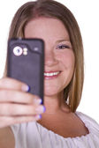 Woman taking pictures from her cell phone — Stock Photo