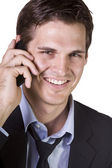 Young businessman conversing on cell phone — Stock Photo