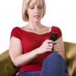 Beautiful Woman Texting on the Couch — Stock Photo