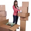 Young girl packing up and moving - isolated — Stock Photo