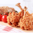 Chicken drumsticks coated with corn flakes — Stockfoto