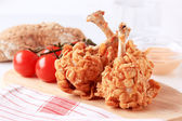 Chicken drumsticks coated with corn flakes — Stock Photo