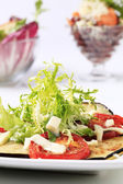 Grilled vegetables and salad greens — Stock Photo