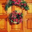 Christmas wreath on door — Stock Photo #4151281