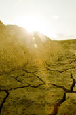 Sun setting over arid land — Stock Photo