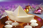 Floating Candles and Paper Boat in Bowl of Water — Stock Photo