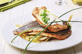 Pan fried trout fillets and baked potato — Stock Photo