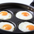 Four fried eggs — Stock Photo