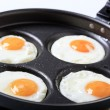 Four fried eggs - Stock Photo